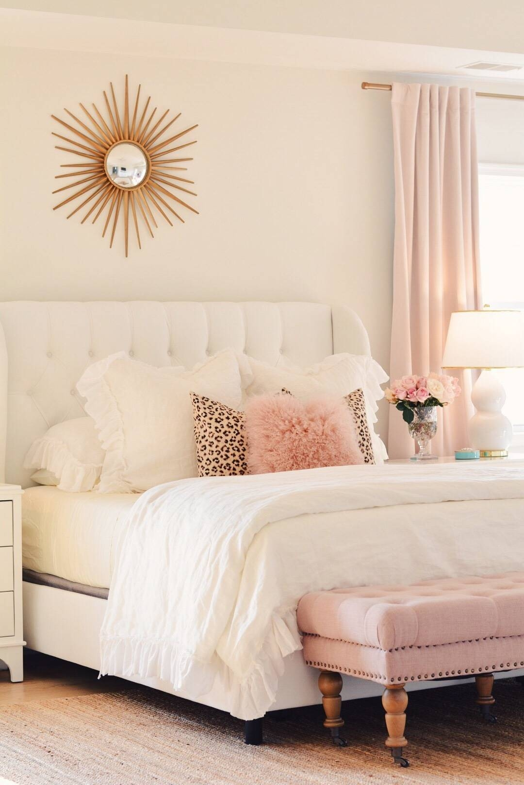 White tufted headboard and pink bench